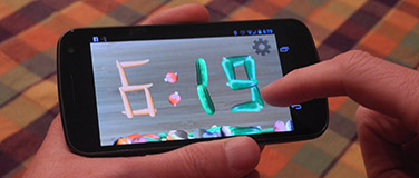 Image of a finger tapping a phone running Veggie Clock